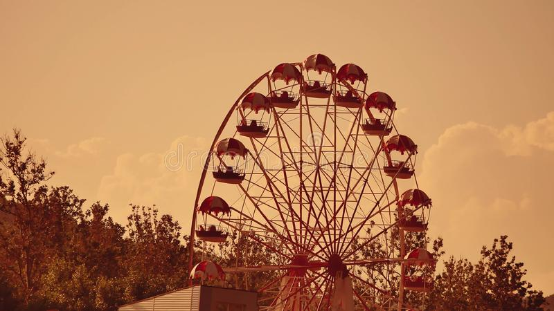 Amusement park sunset. Ferris Wheel Over Blue Sky. Amusement park royalty free stock image