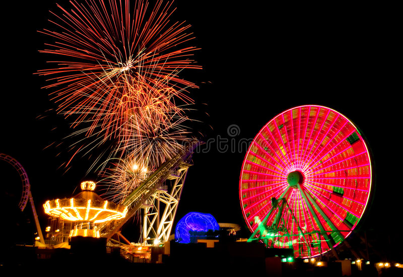 Download Amusement Ride & Fireworks stock photo. Image of bright - 5802450