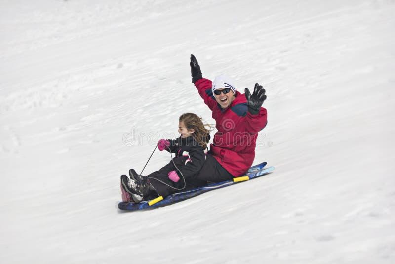 Amusement sledding de neige image libre de droits