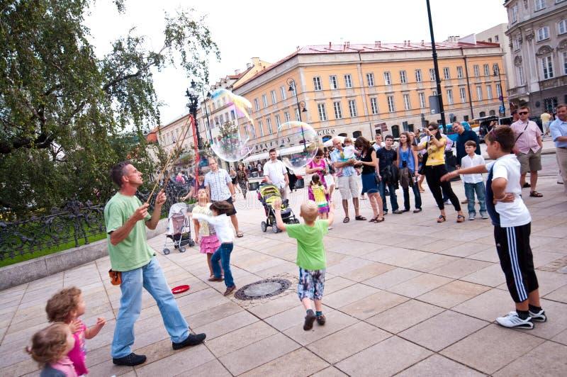 Amuseur de rue à Varsovie photographie stock libre de droits