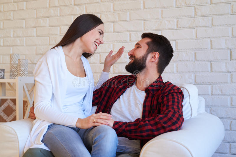 Amusing couple making merry over communicating, close-up shot stock image