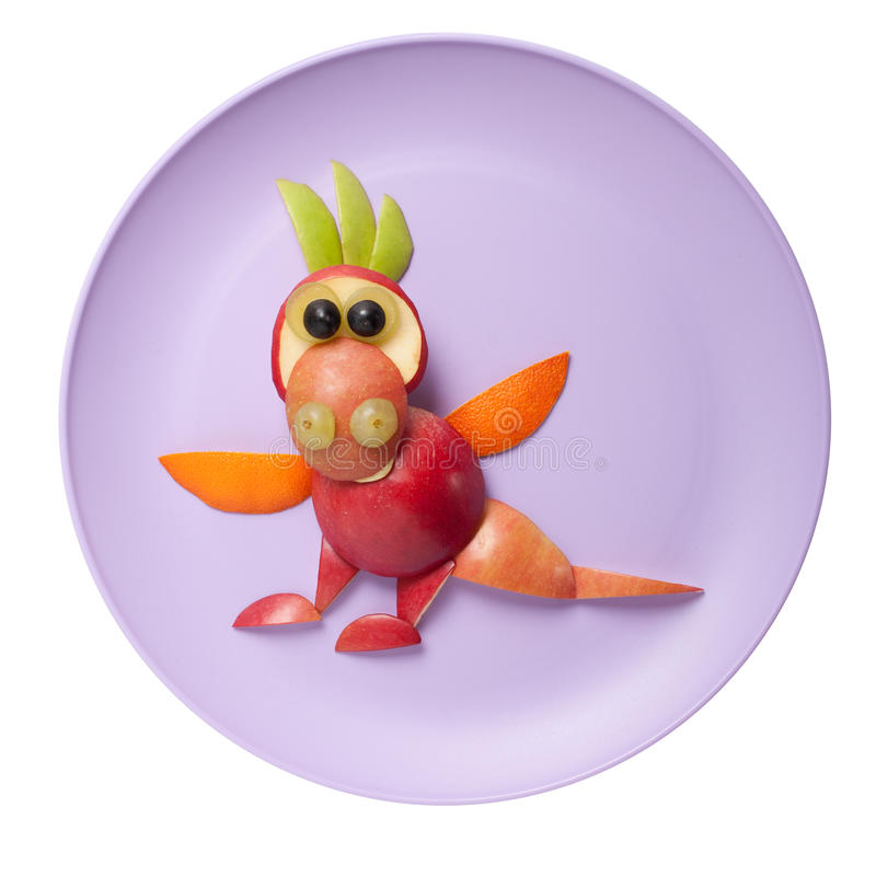 Amusing dragon made of apple stock images