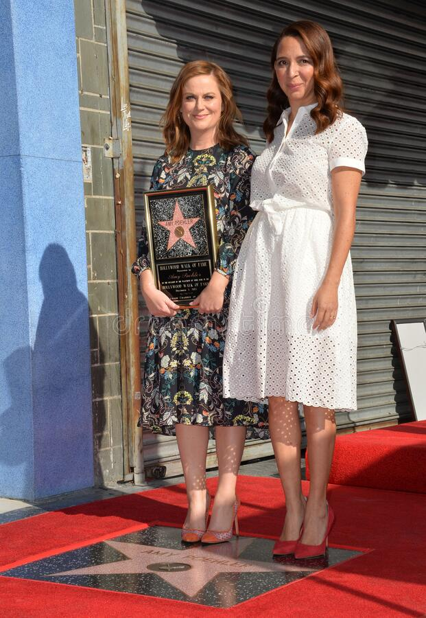 Amy Poehler & Maya Rudolph. LOS ANGELES, CA - DECEMBER 3, 2015: Actresses Amy Poehler & Maya Rudolph on Hollywood Boulevard where Poehler was honored with the 2 stock photography