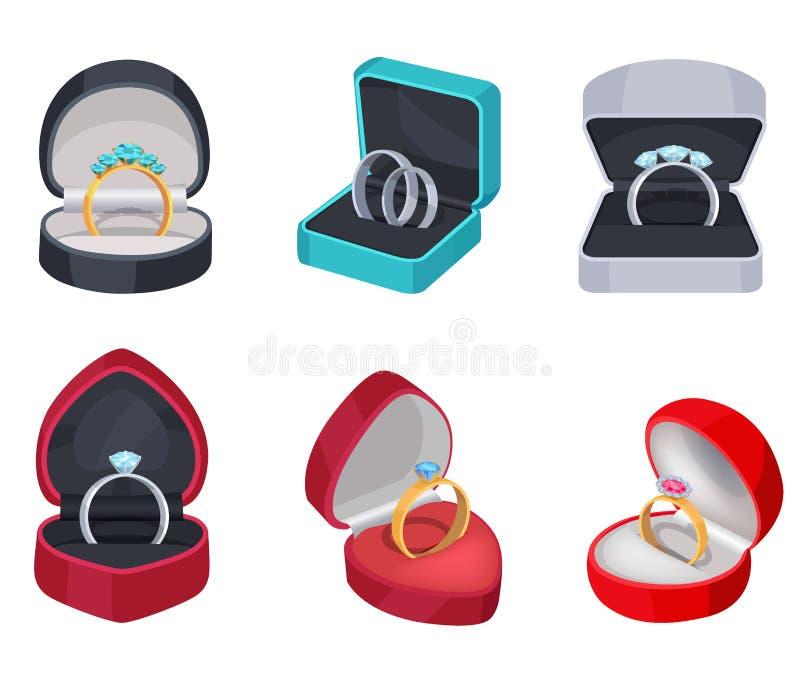 Anéis do ouro e da prata com as pedras na caixa de presente ilustração stock