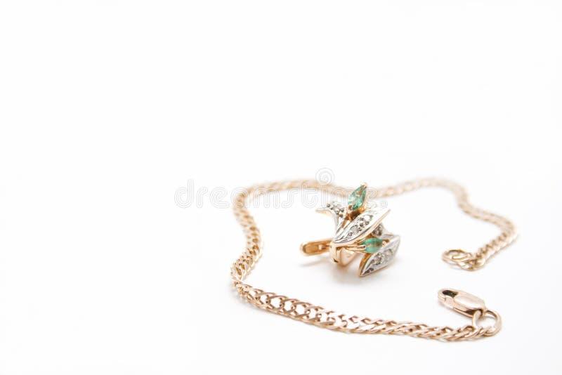 Anéis dourados do bracelete e de orelha fotos de stock