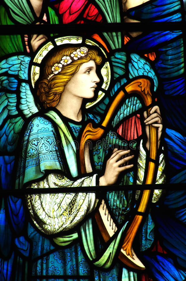 Free An Angel Making Music In Stained Glass Royalty Free Stock Images - 54603649