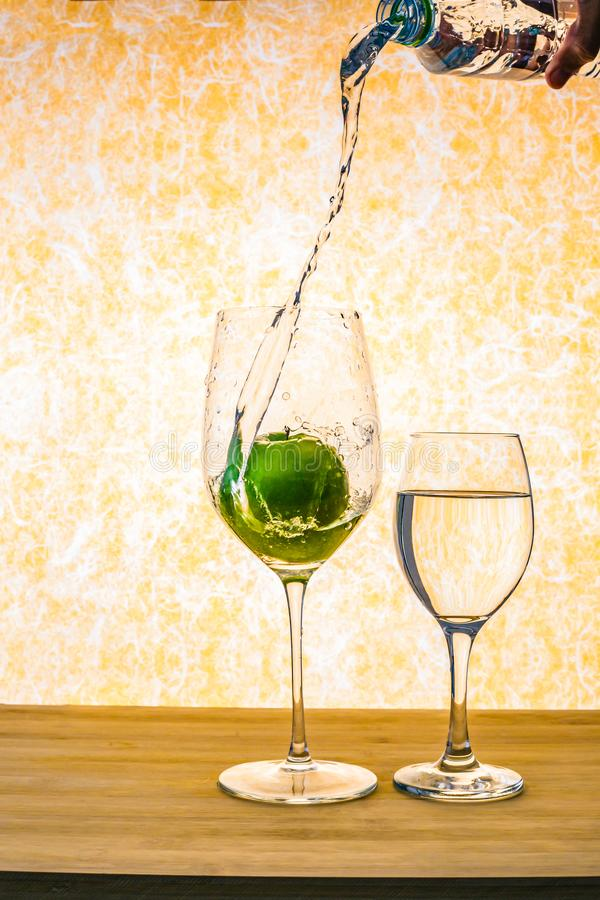 Free An Apple In Wine Glass With A Water Splash. Stock Photos - 122351943