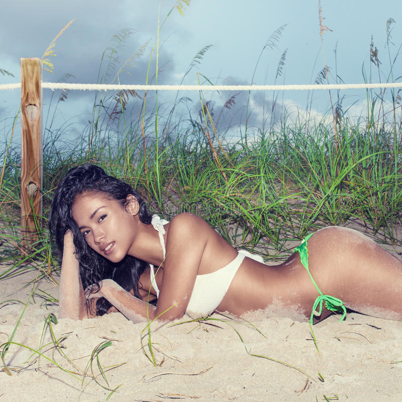 Free An Attractive Asian Model On The Beach On A Sunny Day Stock Image - 76281931