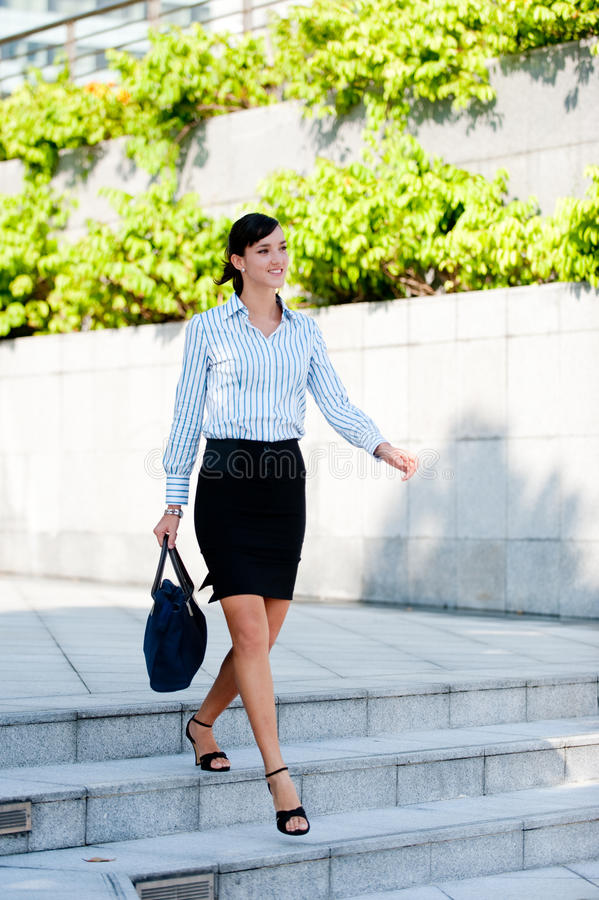 Free An Attractive Businesswoman Walking Stock Photography - 9799862