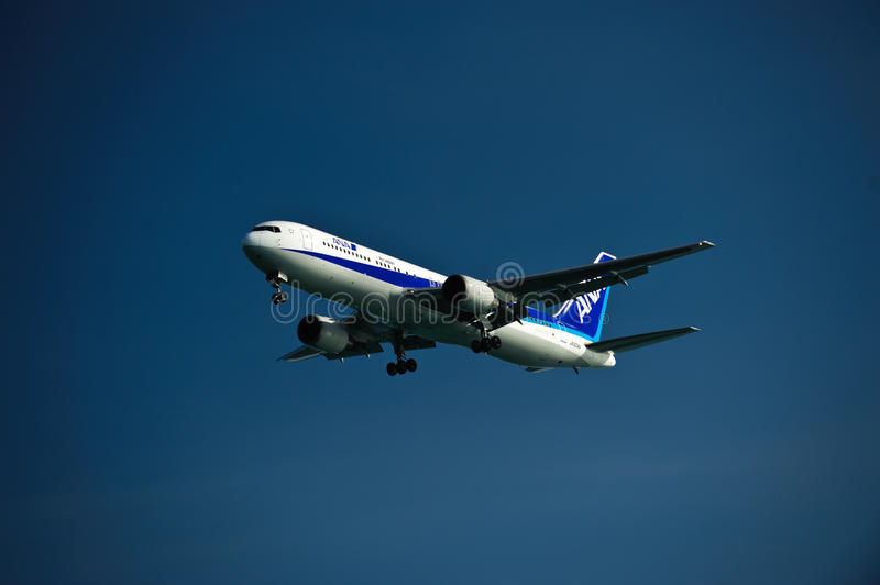 ANA 767-300ER on Final. All Nippon Airway Boeing 767-300ER with landing gears and flaps down on final approach on a cloudless day stock photos