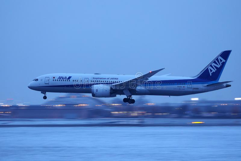 Ana All Nippon Airways plane landing on snow. Y runway, Munich Airport, MUC, winter royalty free stock photo