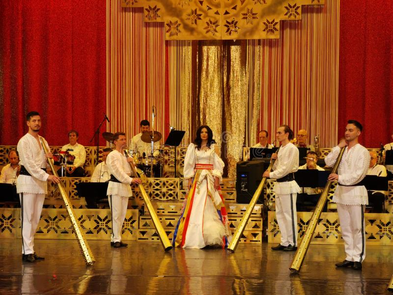 Ana Maria Donosa surrounded by guys with horn at Theater of the Magazine Constantin Tanase. Ana Maria Donosa surrounded by guys with horn on the stage at Theater royalty free stock image