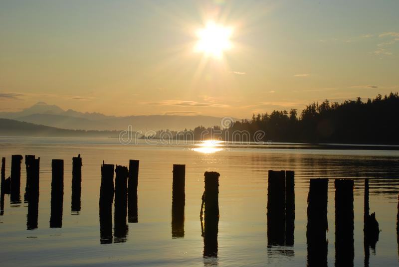 Anacortes Port and Pilings at Sunrise imagens de stock