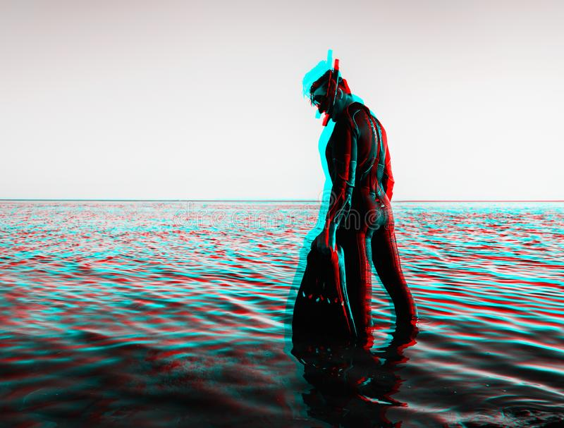Anaglyph effect of man in a diving suit with flippers. stock image