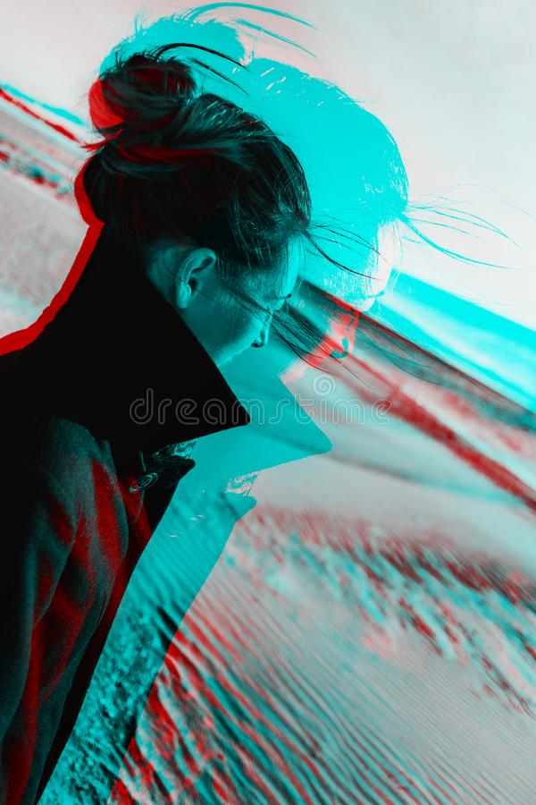 Anaglyph effect of woman in sand places. royalty free stock photography