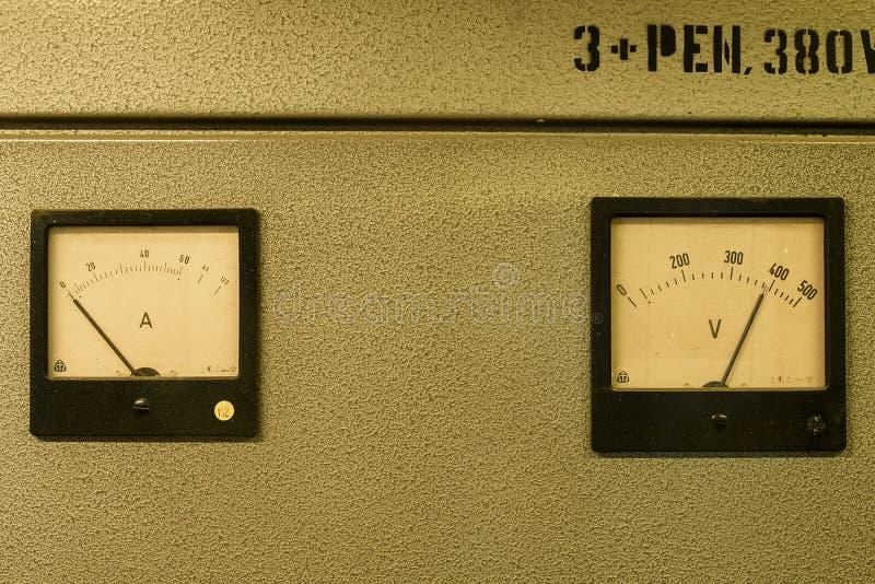 Analog ampere meter or amp meter and analog voltmeter stock images