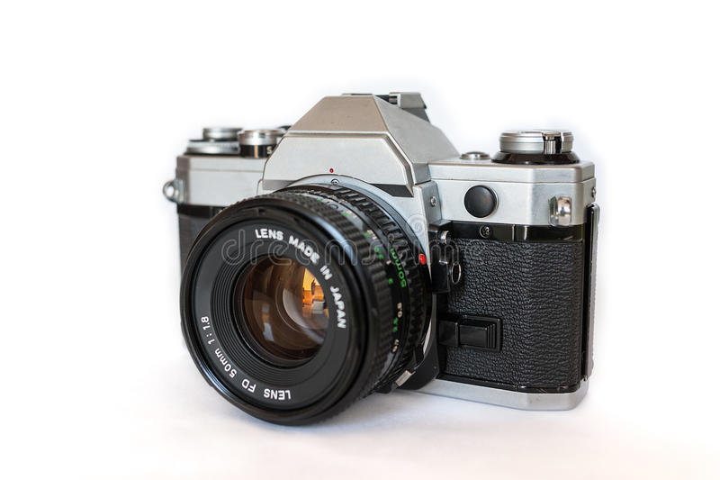 Analog camera. Vintage analog slr camera with lens attached stock photos