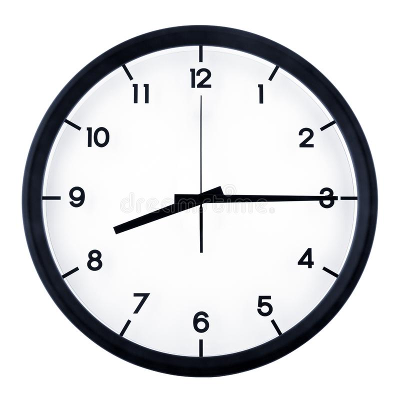 Analog clock. Classic analog clock pointing at eight fifteen o`clock, isolated on white background royalty free stock images