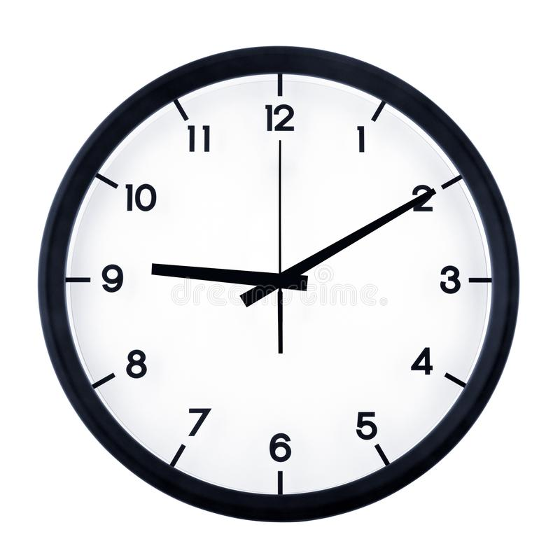 Analog clock isolated. Classic analog clock pointing at nine ten, isolated on white background royalty free stock photo