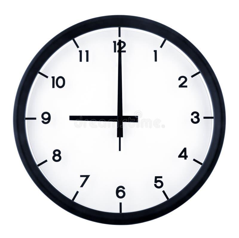Analog clock. Classic analog clock pointing at 9 o`clock, isolated on white background stock image
