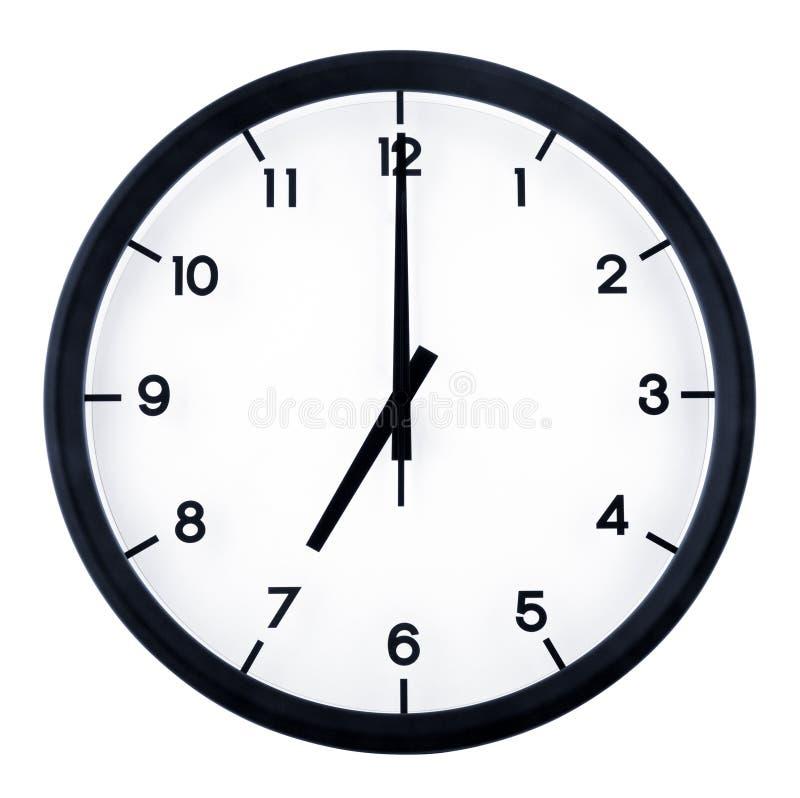 Analog clock. Classic analog clock pointing at 7 o`clock, isolated on white background royalty free stock image