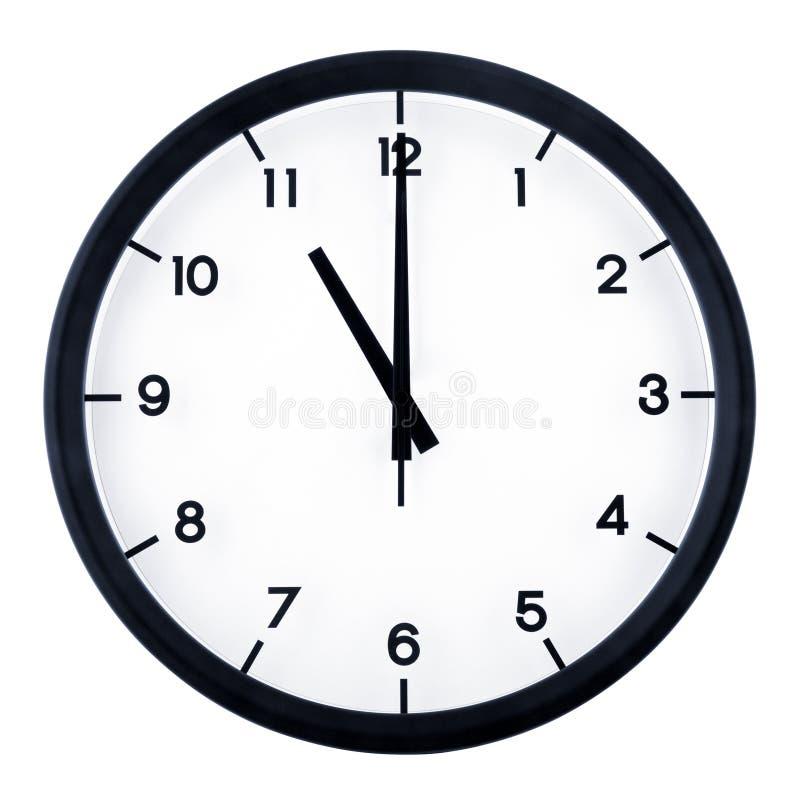 Analog clock. Classic analog clock pointing at 11 o`clock, isolated on white background royalty free stock image