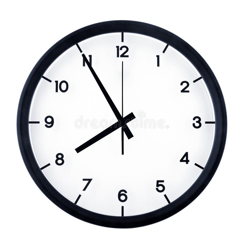 Analog clock isolated. Classic analog clock pointing at seven fifty five, isolated on white background stock photo