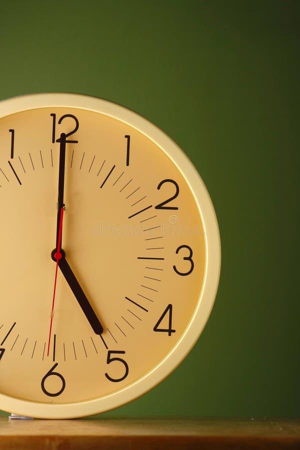 An analog clock at five o'clock position. Photo of an analog clock at five o'clock position royalty free stock photo