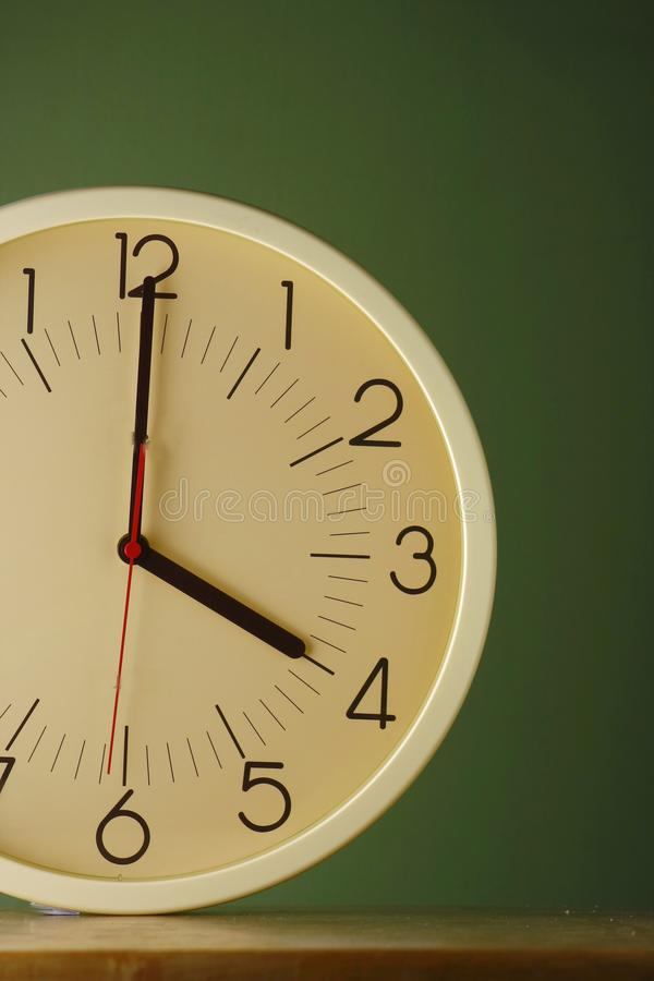 An analog clock at four o'clock position. Photo of an analog clock at four o'clock position royalty free stock images
