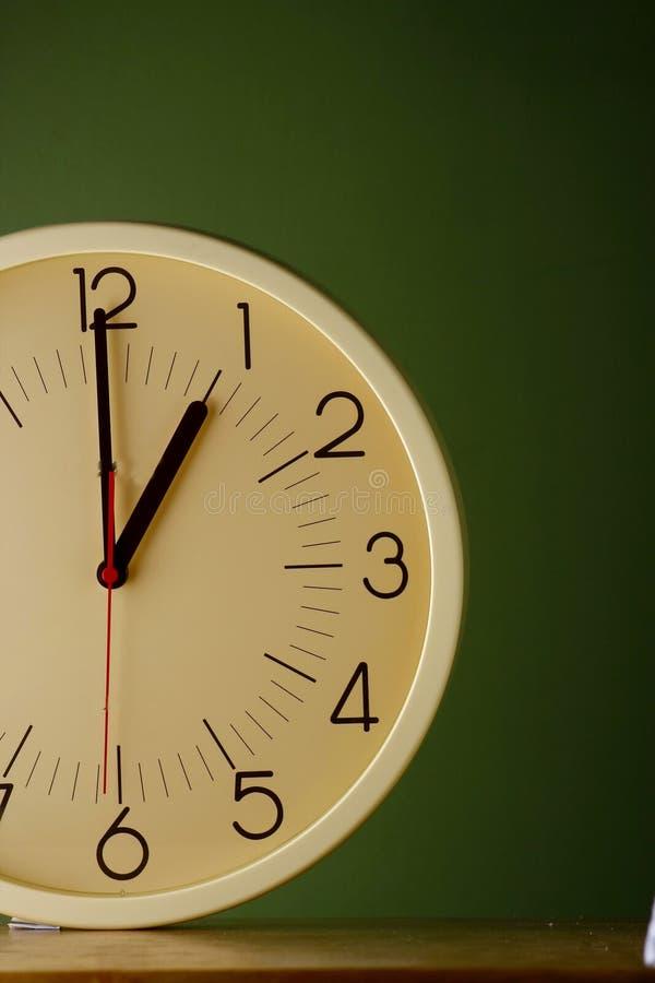 An analog clock at one o'clock position. Photo of an analog clock at one o'clock position royalty free stock photo