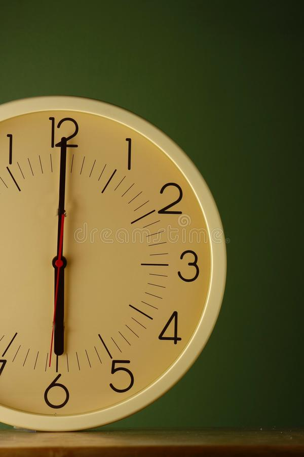 An analog clock at six o'clock position. Photo of an analog clock at 6 o'clock position stock photo
