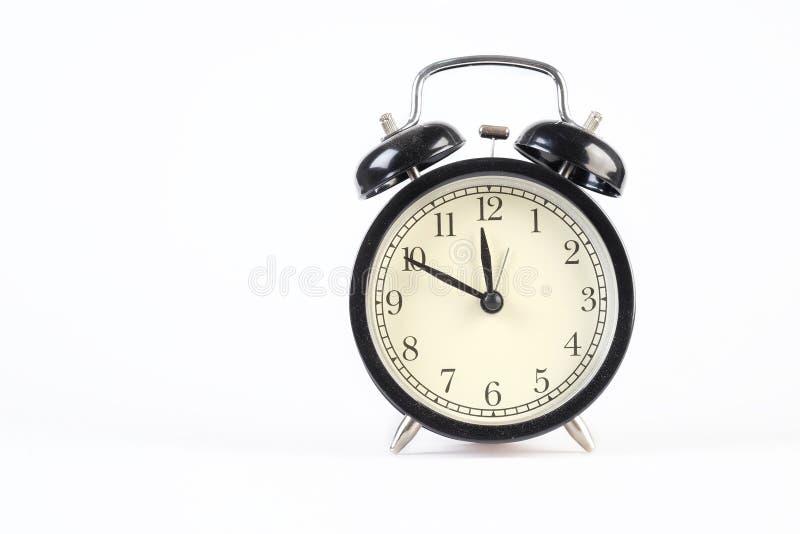 Analog clock telling time. At ten to twelve o`clock stock photography