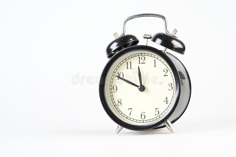Analog clock telling time. At ten to twelve o`clock stock photo