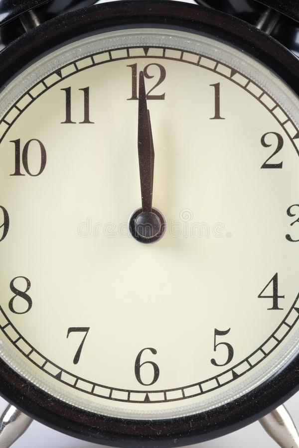 Analog clock telling time. At twelve o`clock royalty free stock images