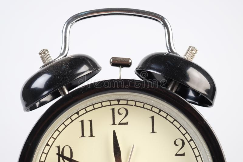 Analog clock telling time. At ten to twelve o`clock royalty free stock photos
