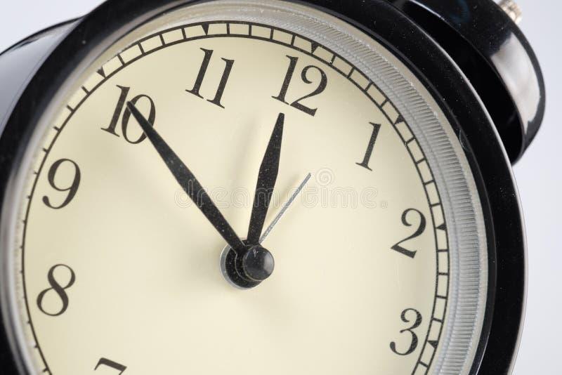 Analog clock telling time. At ten to twelve o`clock stock photos