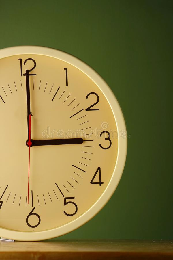 An analog clock at three o'clock position. Photo of an analog clock at three o'clock position stock photos