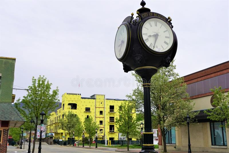 Main street Beacon New York on sleepy sunday morning. Analog clock tower in City of Beacon shows early morning hour of April 28, 2019.  Construction in stock photography