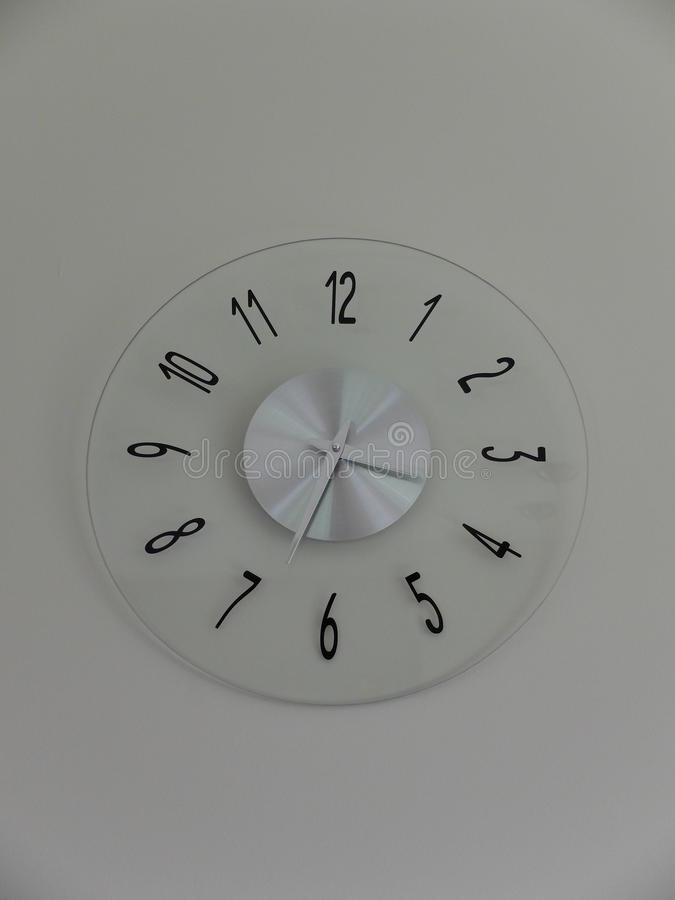 Analog clock. Transparent analog clock on a wall stock photos