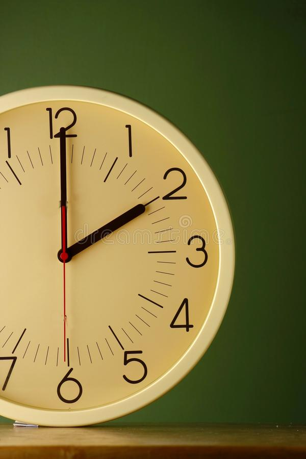 An analog clock at two o'clock position. Photo of an analog clock at two o'clock position royalty free stock photo