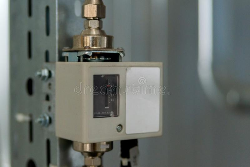 Analog device regulator for efficient automated heating system. Thermostat, appliance, button, cold, control, display, electric, energy, heater, modern, panel royalty free stock images
