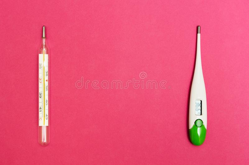 Analog and digital thermometer on a pink background, space for text stock photography