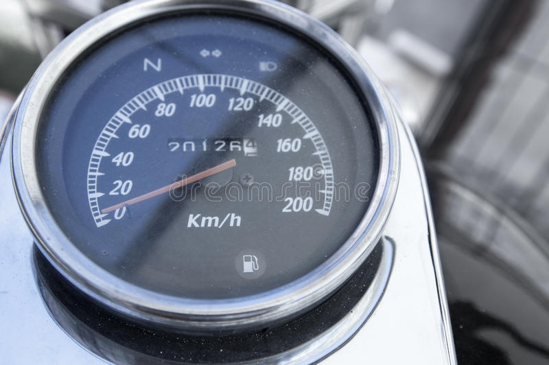 Analog Instrumentation Guage for a Motorcycle. Analog instrumentation display guage for a motorcycle, with chrome rim, speedometer and odometer, as well as fuel stock photography