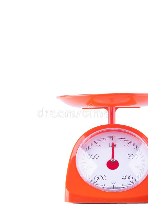 Analog kitchen weight scale on white background kitchen equipment object isolated stock photo