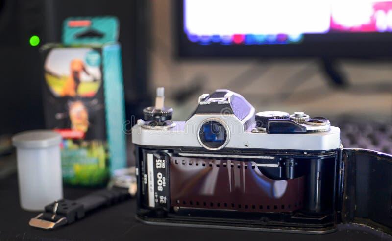 Analog life concept, Retro classic film camera and film roll on desktop. Analog life concept, Retro classic film camera and film roll on  desktop stock photo