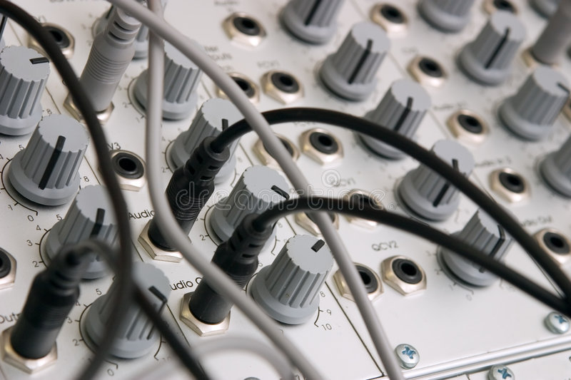 Analog modular synth. Closeup of an analog modulare synthesyzer in a recording studio royalty free stock photos