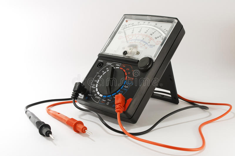 Analog Multimeter. Analog multimeter is on stand, close-up on a white background stock photos