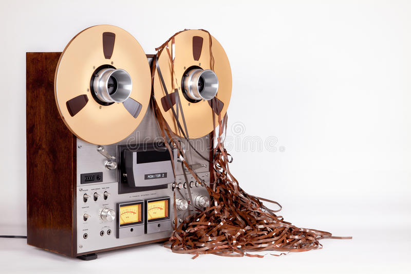 Analog Open Reel Tape Deck Recorder with Messy Tape. Analog Open Reel Tape Deck Recorder with Messy Tangled Tape on white royalty free stock photos