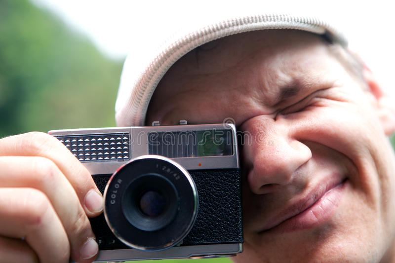 Analog portrait. Person makes a photo with an old analog camera stock image