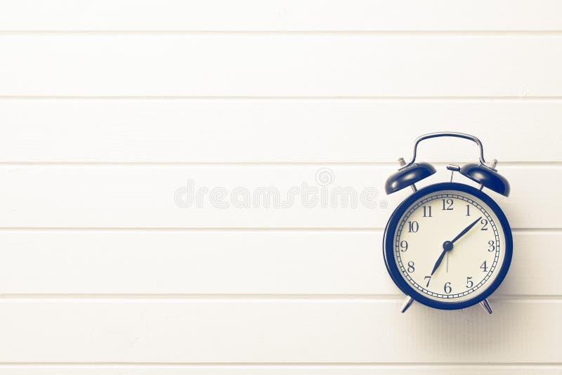 Analog retro alarm clock. Top view of analog retro alarm clock stock photos